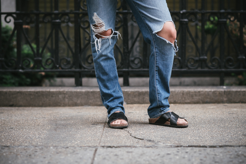 Ripped jeans and slides