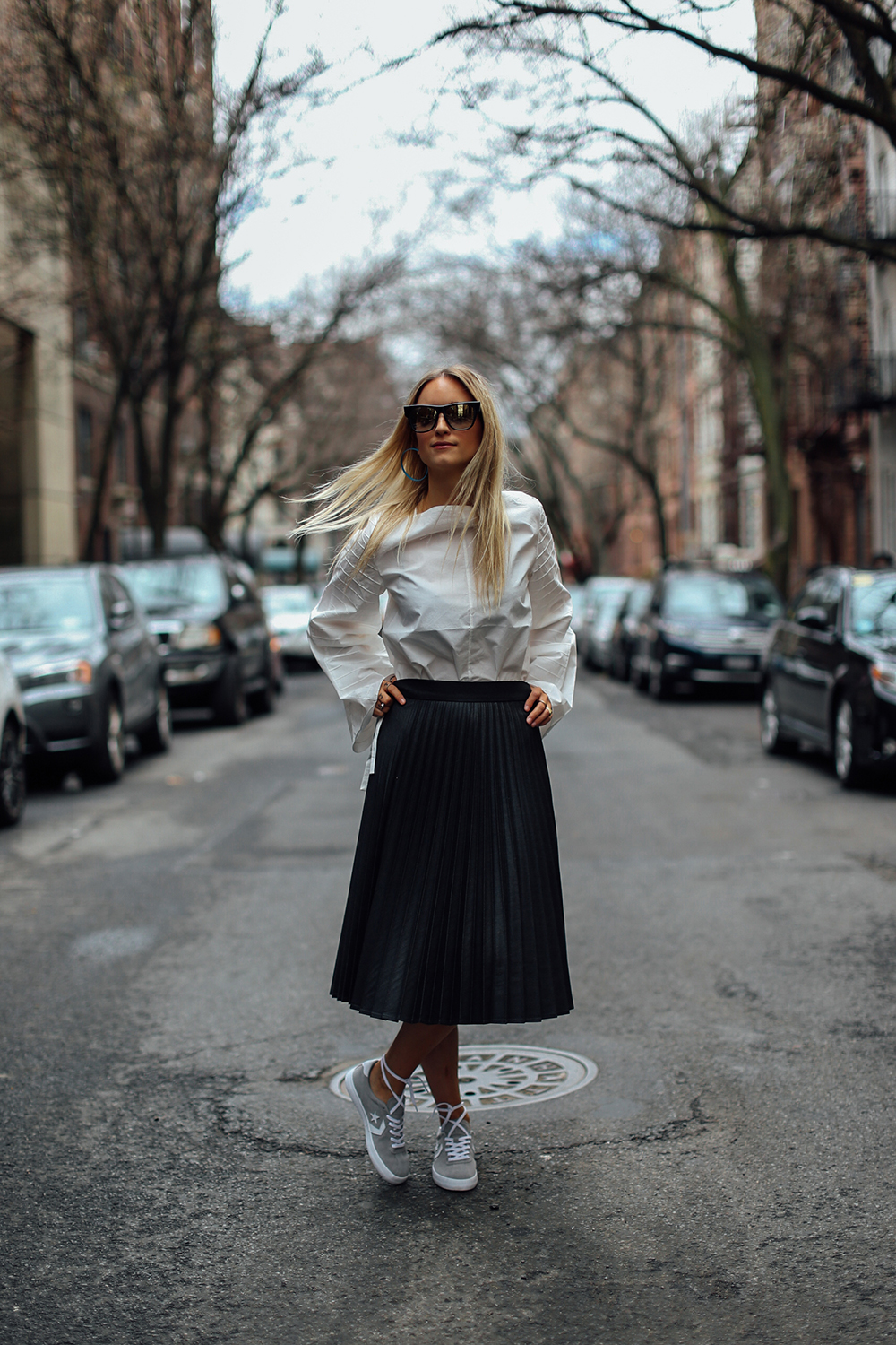 Charlotte Groeneveld Thefashionguitar in Converse sneakers via DSW and Tibi top